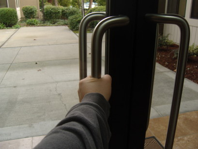 What's your natural reaction to a vertical door handle?  You grab it like this...